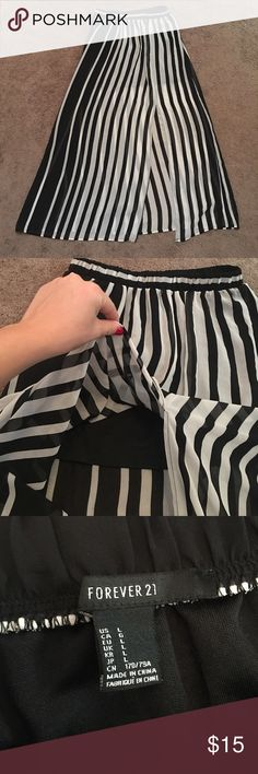 Forever21 Black and White Skirt Beautiful black and white skirt with a side slit. The outer layer is sheer but it comes with an under layer that protects you from being all out in the open. The under layer is shorter than the sheer so it will show the shadow of your legs. Elastic waist. In great condition! Would look perfect with a bandeau/crop top. :) Measurements upon request Forever 21 Skirts Maxi