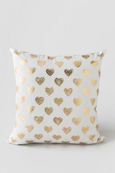 Gold Hearts Pillow. Shiny gold hearts are printed on the front of the pillow for…