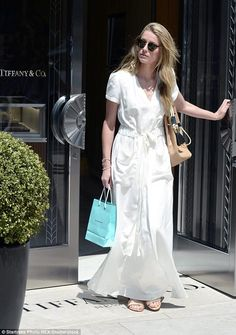 Splashing cash: Amber Heard is pictured leaving Tiffany And Co in Los Angeles on Tuesday, ...