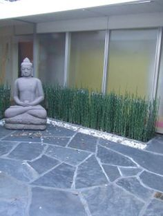 flagstone statute and horestail reed in atrium...again, right elements, executed poorly.