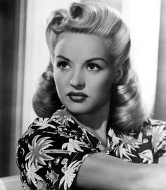 """""""Victory rolls"""" hairstyle (1940s)."""