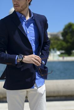 Navy jacket blazer sport coat. Blue shirt. Light gray pants. Smart casual. Summer wear.