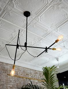 Simple white pressed tin tiles will add interest and texture to the ceiling without distracting from the other design elements. And how about that fabulous light fixture! Love the mix of industrial/rustic alongside the vintage elegance of the tin tiles. #LGLimitlessDesign #contest