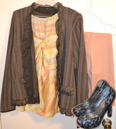 A peach and yellow watercolor blouse under a ruffle trimmed jacket paired with peach pants and animal print pumps.