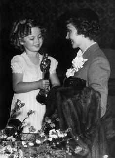 Shirley Temple Gives Claudette Colbert an Oscar