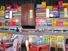 This place is so colorful! I love the sugar skull & mexican fighter chairs ^_^ // Santos Diablitos   interiorism by Henriquez Lara Studio