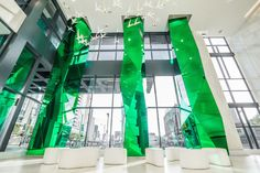 Fly Condos | Faceted Mirrored Glass Columns  #glass #architecture #columns