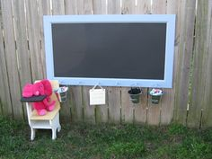 The frame and chalkboard surface are plastic. Pretty cool idea for an outdoor play area.