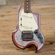 Reshaped 1960s Fender Mustang in Psychedelic Finish. Whatchya think? Love it or loathe it?