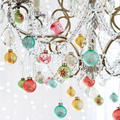"FIRST NOEL BLOWN GLASS ORNAMENTS, SET OF 12 -- The holiday palette re-spun in luminous pastel ornaments, made of handblown mercury glass and deftly handpainted with a sprinkling of glitter. Imported. Exclusive. Set of 12. 1-1/2"" dia."