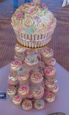 Mini-cake made to look like a cupcake for the cake cutting! Great idea for our cupcake display.