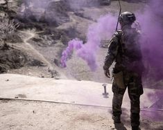 A coalition Special Operations Forces soldier marks a medical evacuation helicopter landing zone during a mission in Nuristan province, Afghanistan, April 12. (U.S. Navy photo by Mass Communication Specialist 2nd Class Clay Weis / Not Released)