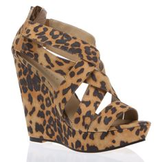 Go ahead and be a wild child in this funky and fashionable, leopard-print crisscross wedge.