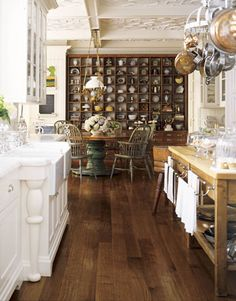 I adore the island/table and the beautiful turned legs by the sink.  Such a gorgeous eclectic mix.