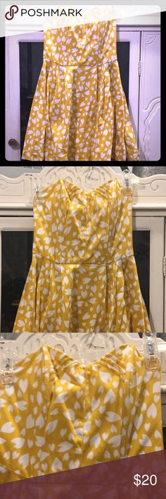 Material Girl Dress Cute little yellow and white strapless mini dress (feels like cotton material). Gently worn, small black mark by zipper on the backside- might come out with some laundry skills better than my own!   Reach out with any questions or offers!  Runs more like XS than Small. Has 2 pieces of boning in the front helping to hold the dress up. Material Girl Dresses Mini