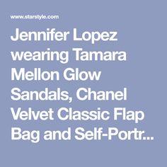 Jennifer Lopez wearing Tamara Mellon Glow Sandals, Chanel Velvet Classic Flap Bag and Self-Portrait Tiered Guipure Black Lace Mini Dress