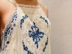 Oh my gosh I would love to own this, beautiful blue lace tank top