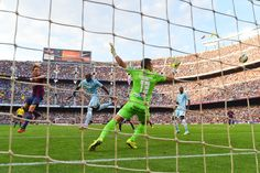 Ivan Rakitic of FC Barcelona (L) scores his team's second goal during the La Liga match between FC Barcelona and Granada CF at Camp Nou on September 27, 2014 in Barcelona, Catalonia.