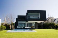 Modern black house on the lake