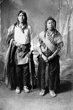 Image No: NA-896-3  Title: Two of the first pupils at the Blackfoot Anglican School.  Date: [ca. 1886]  Photographer/Illustrator: Ross, Alexander J., Calgary, Alberta.  Remarks: Copy of PA-124-76.  Subject(s): Blackfoot - Clothing   Order this photo from Glenbow: ww2.glenbow.org/search/archivesPhotosResults.aspx?XC=/sea...  Search for 99,999 other historical photos at Glenbow: ww2.glenbow.org/search/archivesPhotosSearch.aspx