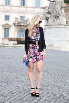 Colorful Palette: floral printed black romper, drape front open jacket, Brahmin cobalt clutch, Prada suede platform sandals, how to wear a romper for fall, fall romper outfit