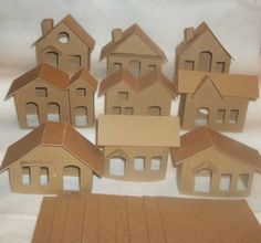 Vintage Putz Style Houses -  Vintage Set of 9 Houses by littlevillagehouses on Etsy https://www.etsy.com/listing/224240814/vintage-putz-style-houses-vintage-set-of