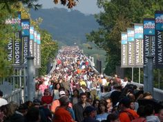 """""""Walkway over the Hudson"""" is now a Pedestrian walkway bridge that used to be a railroad bridge many, many years ago.  It spans over the Hudson River, and is a Historic State Park....The picture is from the opening day of the Walkway."""