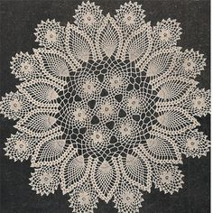 Crocheted Pineapple Rose Motif Doily Pattern. Looks like a cathedral window. Sunflower colors would be gorgeous!!