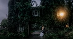 arbor crest wedding portrait bride groom under stone and ivy arch with a tilt shift lens Matt Shumate Photography