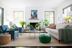 You'll Envy This Effortlessly Cool Family Home // green Moroccan pouf, blue arm chair, yellow table lamp, neutral sofa