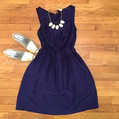 Anthropologie Silk dress Gorgeous navy silk dress from Anthropologie. Ruffle detail down chest, elastic at waist and small tie detail at back neck. So lightweight and classic! Anthropologie Dresses Mini