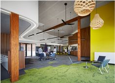 Grassland in the reading space, a swamp in the learning area & grassy shoreline along the perimeter. Floor designs inspired by nature and patterned from nature. Biophilic floors and interiors are popular in offices and commercial spaces. Like this collaboration space, the different themes in the floor pattern adds character to the space and encourages creativity and involvement.