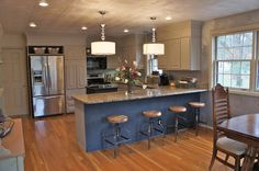 Removed ugly soffits and built cabinets to the ceiling. Low cost cabinet makeover by Bella Tucker Decorative Finishes.