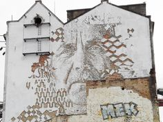 mural on alcantra building by vhils