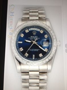 Blue faced Rolex with Diamonds around it.  LOVE - It is the women's version of my Dad's blue faced one, except my Dad's doesn't have the diamonds surrounding the outside of the face.
