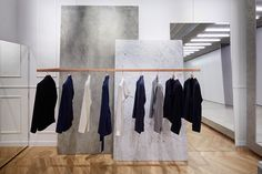 one of the more interesting boutiques to have opened in paris lately offers contemporary menswear amidst an understated setting of monolithic furnishings in marble and concrete.