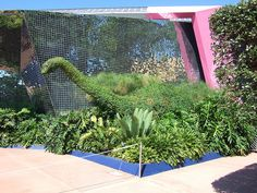 Dinosaur topiary at the Universe of Energy Made by Stefan Przystanski in 1986 for Rockefeller Center.