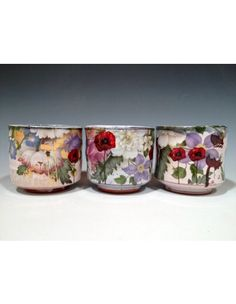 This set of 3 earthenware Poppy cups are exquisite. Potter Justin Rothshank used vintage flower decals, custom laser toner transfers, poppy decals and gold luster poppy decals to create one-of-a-kind designs with layer upon layer of beautiful images. $220 for the set of three. #ceramics