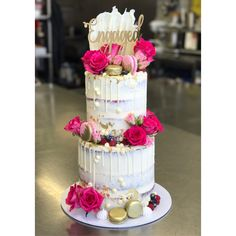 Two tier engagement cake, white chocolate drip, macarons, cake topper