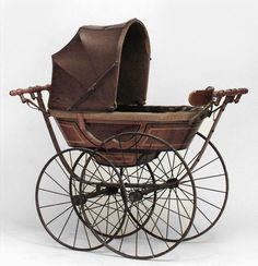 """English Victorian pine painted and ebonized trim """"CEE"""" spring baby carriage (per"""