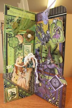 Magic of Oz - manila folder mini with lots of tags (photos only) Magic Of Oz, Manila Folder, Library Pockets, Mini Library, Scrapbook Paper, Scrapbooking, Tag Photo, Graphic 45, Wizard Of Oz