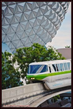 Monorail Lime passing Spaceship Earth on approach to the Epcot station, Walt Disney World, Orlando, Florida.