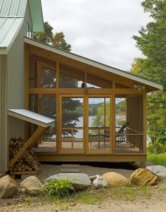 Screened-in lake house porch with a view