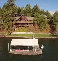 Coveted location on Coeur d' Alene Lake in Cove Point. This home boasts everything you would need including three bedrooms, 2.5 bathrooms, an open inviting living room, dining room and kitchen for entertaining. Kitchen is bright and cheery with granite, pantry and a view of the lake as do most rooms! Living room is large with vaulted ceilings and has a cozy wood burning crackling fireplace. Other rooms include a loft, a screened in porch, plenty of storage and a laundry room.