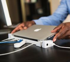 Your lightweight Macbook Air just got a whole lot more powerful with this stylish docking stations.