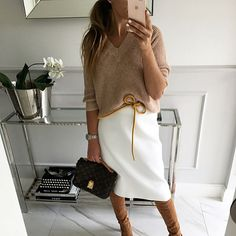 White skirt. Pencil shirt. Amex sweater. Neutrals.