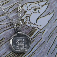 Ship in a Wax Seal neclace by SueGrayJewelry on Etsy http://www.etsy.com/listing/58823197/petite-ship-wax-seal-necklace-in-fine#