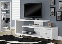 Enhance the look of #your living space with the contemporary styling of this art deco inspired TV stand. Constructed with thick panels in a brilliant white finis...
