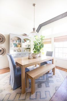 10 Beautiful Faux Fiddle Leaf Fig Trees and Plants for Home Decor natural wood dining room table upholstered denim chairs vaulted ceilings dining room hutch styling beautiful dining rooms, vaulted ceilings dining room, vaulted ceilings wood beams, woven wood blinds, seagrass baskets on wall
