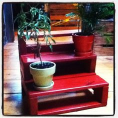 tiered plant stand made from a pallet